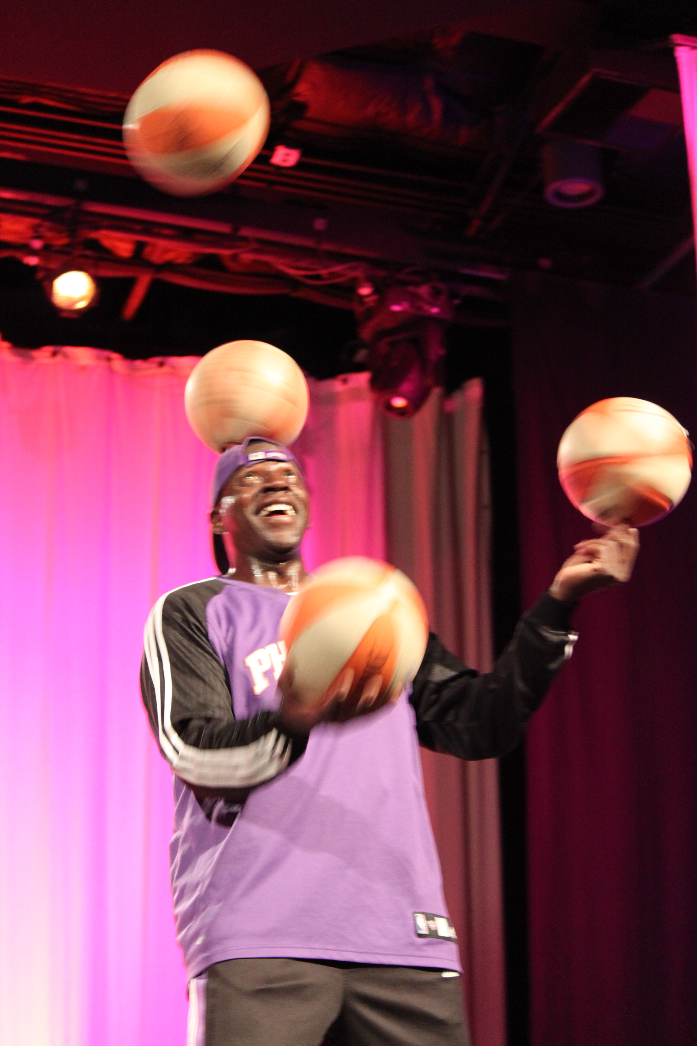 Odhiambo finger-spining, head-spining and juggling